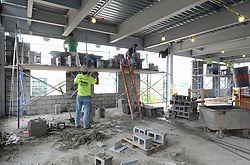 Central Connecticut State University.  New Academic Building.  Project No: BI-RC-324 Contractor: Gilbane Building Company, Glastonbury, CT. Date of Photograph: 19 June 2012 Image No. 63. Camera View: Masons installing wall block, north elevation.