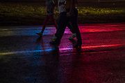WASHINGTON, USA - August 19: A family walks through the rain slicked parking lot of the Montgomery County Agricultural Fair in Gaithersburg, Md., USA on August 19, 2017.