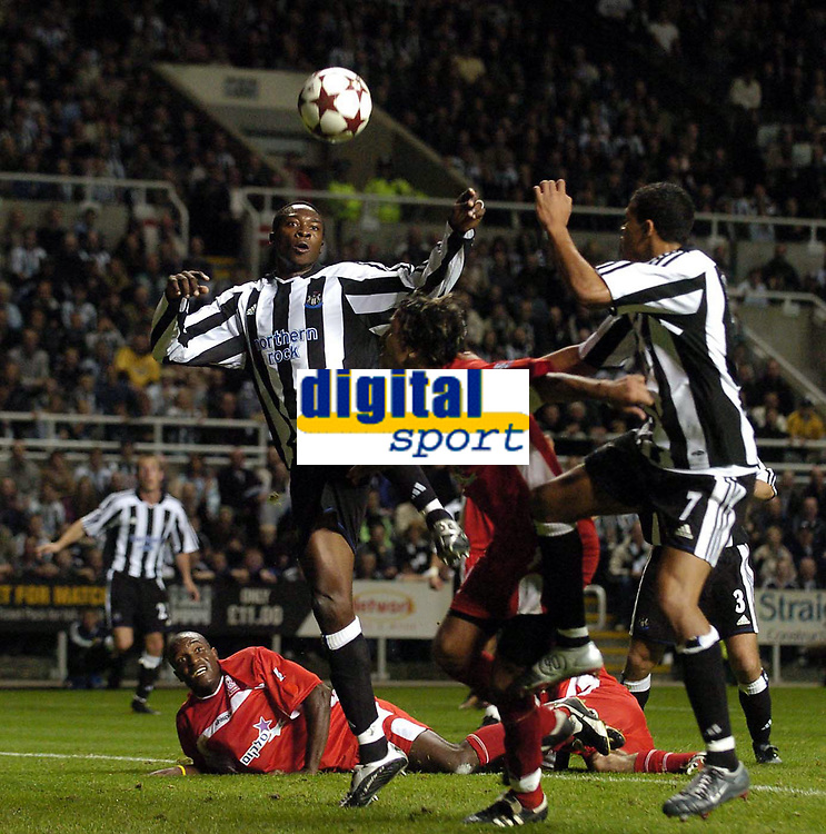 Photo. Jed Wee.<br /> Newcastle United v Hapoel Bnei Sakhnin, UEFA Cup, 16/09/2004.<br /> Newcastle's Shola Ameobi causes trouble in the Hapoel penalty area<br /> NORWAY ONLY