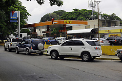 May 23, 2019 - Valencia, Carabobo, Venezuela - May 23, 2019. Drivers line up to supply gasoline at the service station Parque Trigal,  in the city of Valencia, Carabobo state. Photo: Juan Carlos Hernandez (Credit Image: © Juan Carlos Hernandez/ZUMA Wire)