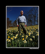 February 28, 2012 - Ball Ground: Jim Gibbs stands inside one of is many daffodil gardens  at Gibbs Garden on Tuesday, February 28, 2012. James Gibbs, is opening his personal garden to the public, a space that has taken 30 years to cultivate with more than 5 million daffodils, a massive Japanese garden, swaths of roses and perhaps more plantings than the Botanical Garden itself. This makes it potentially one of the most important public gardens in the South.  Johnny Crawford