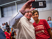 "15 JUNE 2019 - BOONE, IOWA: Governor KIM REYNOLDS (R-IA) poses for a ""selfie"" at ""Joni's Roast and Ride,"" an annual fund raiser held by US Senator Joni Ernst (R-IA). Ernst, Iowa's junior US Senator, kicked off her re-election campaign during the ""Roast and Ride"", an annual fund raiser and campaign event has she held since originally being elected to the US Senate in 2014.  PHOTO BY JACK KURTZ"