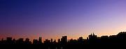 USA, NY, New York City, Manhattan Panoramic view of the skyline at dusk