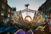 The setting sun shines through an elaborate carnival outfit in Ridley Road  in East London, United Kingdom,Sept 11 2016. The annual Hackney Carnival took place on a hot summers day and the procession of dancers dressed in various outfits moved through the streets to much joy of the many bystanders.