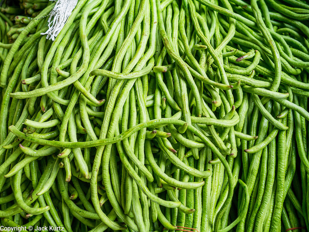 08 JANUARY 2013 - BANGKOK, THAILAND:   Long beans for sale in the produce section of the Bangkok Flower Market. The Bangkok Flower Market (Pak Klong Talad) is the biggest wholesale and retail fresh flower market in Bangkok. It is also one of the largest fresh fruit and produce markets in the city. The market is located in the old part of the city, south of Wat Po (Temple of the Reclining Buddha) and the Grand Palace.    PHOTO BY JACK KURTZ