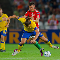 Sweden's Zlatan Ibrahimovic (front) fights for the ball with Hungary's Adam Pinter (back) during the UEFA EURO 2012 Group E qualifier Hungary playing against Sweden in Budapest, Hungary on September 02, 2011. ATTILA VOLGYI