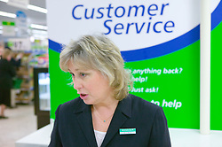 Customer service manager at a supermarket giving consumer advice,
