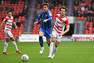 John Marquis of Doncaster Rovers (9) passed the ball forward as Alex Lacey of Gillingham (4) tries to get to the pass during the EFL Sky Bet League 1 match between Doncaster Rovers and Gillingham at the Keepmoat Stadium, Doncaster, England on 20 October 2018.