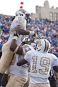 Dec 1, 2012; Tulsa, Ok, USA; University of Central Florida Knights offensive lineman Jordan McCray (63) lifts wide receiver Breshad Perriman (81) as wide receiver Josh Reese (19) looks on following a touchdown during a game against the Tulsa Hurricanes at Skelly Field at H.A. Chapman Stadium. Tulsa defeated UCF 33-27 in overtime to win the CUSA Championship. Mandatory Credit: Beth Hall-USA TODAY Sports