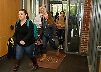 David Warrender greets students as they arrive to the Huot Technical Center on Thursday morning for classes.  (Karen Bobotas/for the Laconia Daily Sun)