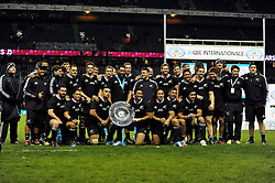 The victorious New Zealand team pose with the Hillary Shield after the match - Photo mandatory by-line: Patrick Khachfe/JMP - Tel: Mobile: 07966 386802 16/11/2013 - SPORT - RUGBY UNION -  Twickenham Stadium, London - England v New Zealand - QBE Autumn Internationals.