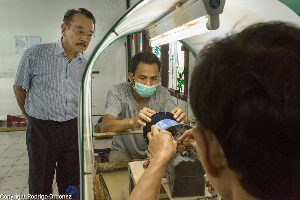 Eztu Glass founder and CEO Brian Yaputra (left) inspect the work of employees at his company's factory in Tangerang, near Jakarta, Indonesia, on July 2, 2015.