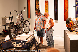 Checking out Raw Iron Choppers' Jesse Srpan's AMOUR 93 inch S&S Knucklehead in the What's the Skinny Exhibition (2019 iteration of the Motorcycles as Art annual series) at the Sturgis Buffalo Chip during the Sturgis Black Hills Motorcycle Rally. SD, USA. Thursday, August 8, 2019. Photography ©2019 Michael Lichter.