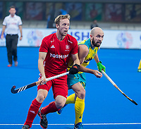 BHUBANESWAR, INDIA - Matthew Swann (Aus) with Barry Middleton (Eng)  , England v Australia for the bronze medal during the Odisha World Cup Hockey for men  in the Kalinga Stadion.   COPYRIGHT KOEN SUYK
