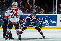 KELOWNA, CANADA - JANUARY 3: Morgan Geekie #28 of the Tri-City Americans lines up against Kyle Topping #24 of the Kelowna Rockets on January 3, 2017 at Prospera Place in Kelowna, British Columbia, Canada.  (Photo by Marissa Baecker/Shoot the Breeze)  *** Local Caption ***
