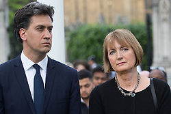 Parliament Square, Westminster, London, June 17th 2016. Following the murder of Jo Cox MP a vigil is held as friends and members of the public lay flowers, light candles and leave notes of condolence and love in Parliament Square, opposite the House of Commons. PICTURED: Ed Miliband and Harriet Harman.