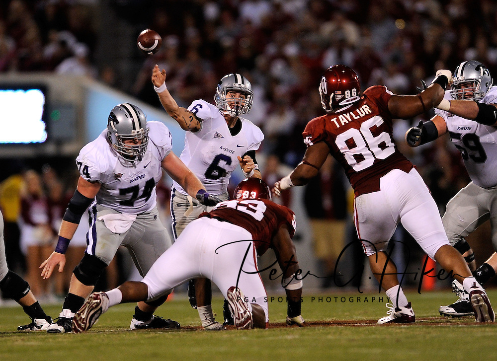 NORMAN, OK - OCTOBER 31:  Quarterback Grant Gregory #6 of the Kansas State Wildcats throws the ball down the field against pressure from the Oklahoma Sooners defense in the fourth quarter on October 31, 2009 at Gaylord Family Oklahoma Memorial Stadium in Norman, Oklahoma.  (Photo by Peter G. Aiken/Getty Images)