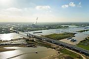 Nederland, Gelderland, Nijmegen, 24-10-2013; <br /> De nieuwe stadsbrug van Nijmegen, De Oversteek met zicht op de zuidoever. Grondwerkzaamheden voor de dijkteruglegging Lent (Ruimte voor de Rivier). De dijken worden landinwaarts verplaatst en er wordt een nevengeul voor rivier de Waal gegraven. Midden in beeld de rookpluimen van de energiecentrale Electrabel Nederland.<br /> The new city bridge of Nijmegen on the river Waal, De Oversteek (The Crossing). Groundworks for the Dike relocation of Lent (project Ruimte voor de Rivier: Room for the River). <br /> luchtfoto (toeslag op standaard tarieven);<br /> aerial photo (additional fee required);<br /> copyright foto/photo Siebe Swart.