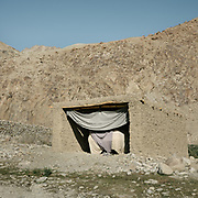 Garage with a car. Cars have been introduced to the Wakhan only in the last couple of years. The life of the Wakhi people, in the Wakhan corridor, amongst the Pamir mountains. Trekking with Paul Salopek.