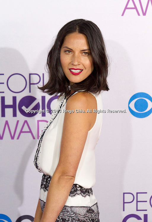 Olivia Munn arrives at the 39th Annual People's Choice Awards at Nokia Theatre L.A. Live on Wednesday January 9, 2013 in Los Angeles, California, United States. (Photo by Ringo Chiu/PHOTOFORMULA.com)