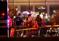 People wait in a medical staging area on Monday, Oct. 2, 2017, after a mass shooting during a music festival Sunday. STEVE MARCUS