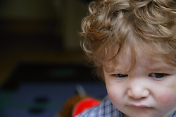 Portrait of baby boy looking puzzled,