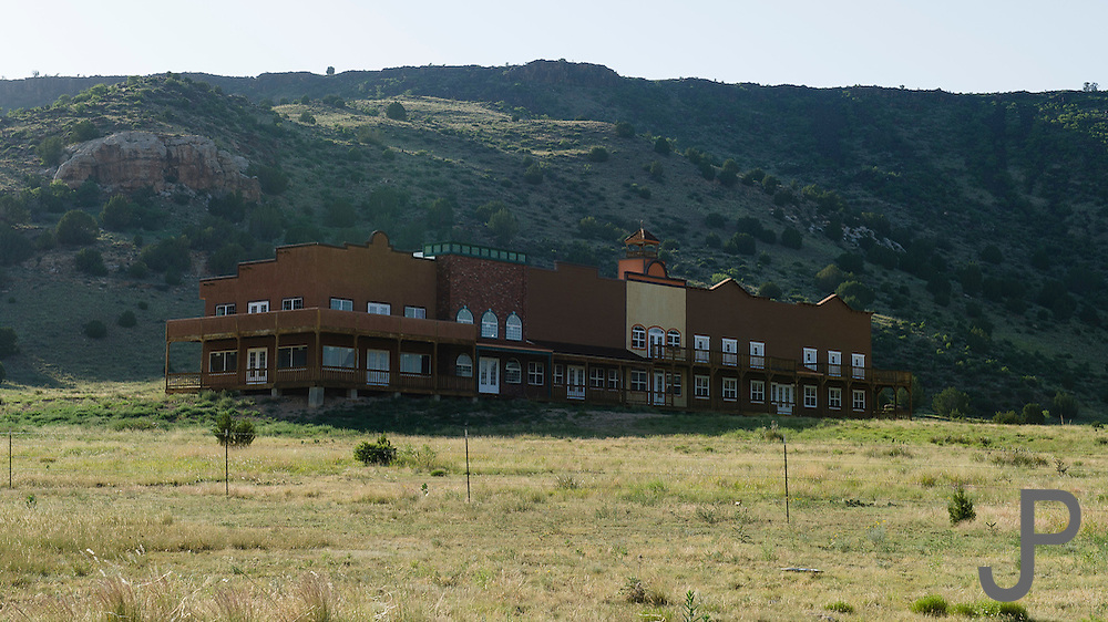 An abandoned hotel sits alone near Black Mesa State Park in far northwestern Oklahoma panhandle.  This was built with the expectation that people would come to the park but the crowds never materialized and the hotel closed quickly.