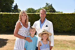 Ben & Marina Fogel and their children Iona & Ludo at the 'Cartier Style et Luxe' enclosure during the Goodwood Festival of Speed, Goodwood House, West Sussex, England. 15 July 2018.