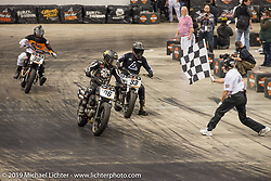 Number 46 Aaron Guardado takes the flag at the Flat Out Friday indoor flat track racing during the Mama Tried Show weekend. Milwaukee, WI. USA. Friday February 23, 2018. Photography ©2018 Michael Lichter.