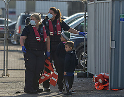 © Licensed to London News Pictures. 22/09/2021. Dover, UK.  Border Force officers assists migrants arriving at Dover Harbour in Kent. Migrants are continuing to attempt the crossing from France as the weather improves this week. Photo credit: Stuart Brock/LNP