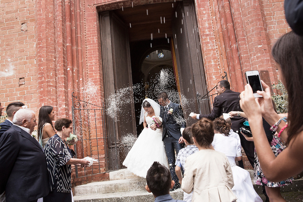 Chiusure (Asciano), Italy - 10 September 2014: A newly married couple is greeted by family and friends as they exit the Abbey of Monte Oliveto Maggiore in Chiusure (Asciano), Italy, on September 9th 2014.