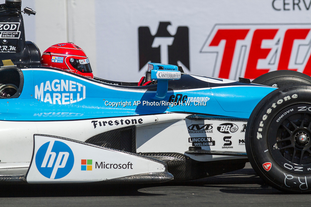 Simon Pagenaud races during the practice for the IndyCar Series 39th Annual Toyota Grand Prix of Long Beach auto race Saturday, April 20, 2013, in Long Beach, Calif.  (AP Photo/Ringo H.W. Chiu)..