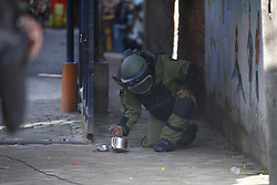 September 20, 2016 - Kathmandu, Nepal - A Nepalese Army bomb disposal personnel defusing a pressure cooker bomb at Kanchanjunga School in Dallu, Kathmandu, Nepal on Tuesday, September 20, 2016. Improvised explosive devices were placed in 7 schools as 2 bombs exploded. No human casualties have been reported in the explosions. (Credit Image: © Skanda Gautam via ZUMA Wire)