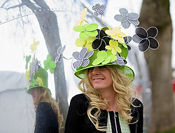 LIVERPOOL, ENGLAND - Friday, April 4, 2014: Wendy Kelly from Redcar wearing a fascinator from Facination online during Ladies' Day on Day Two of the Aintree Grand National Festival at Aintree Racecourse. (Pic by David Rawcliffe/Propaganda)