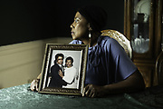 ALABASTER, AL – JUNE 9, 2020: Annie Kynard-Hackworth holds a photograph of her late husband, Herman Hackworth, in the dining room they once shared. Herman Hackworth served honorably in the Korean War, and following his diagnosis with Lewy Body Disease, a rare form of dementia, Kynard-Hackworth transitioned him to Bill Nichols Veterans Home in Alexander City. While there, Hackworth passed away from complications due to COVID-19. CREDIT: Bob Miller for The Wall Street Journal<br /> VETVIRUS