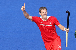 Richard Smith celebrates the equalising goal for Great Britain during the men's hockey match between South Africa and Great Britain held at the Riverbank Arena at Olympic Park in London as part of the London 2012 Olympics on the 1st August 2012..Photo by Ron Gaunt/SPORTZPICS