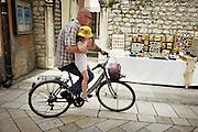 Zadar, Croatia, Jun 16, 2010, Grandfather picking up his granddaughter from school, driving through the Kalelarga. PHOTO © Christophe Vander Eecken  .