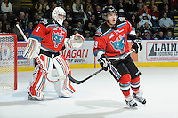 KELOWNA, CANADA, OCTOBER 26: Adam Brown #1 of the Kelowna Rockets keeps his eye on the puck as Myles Bell #29 of the Kelowna Rockets skates on the ice as the Prince George Cougars visit the Kelowna Rockets  on October 26, 2011 at Prospera Place in Kelowna, British Columbia, Canada (Photo by Marissa Baecker/Shoot the Breeze) *** Local Caption *** Myles Bell; Adam Brown;