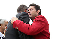 10 October 2013: 2013 inductees Joe-Max Moore (right) and Peter Vermes (left) embrace after Moore's induction. The 2013 National Soccer Hall of Fame Induction Ceremony was held on the West Plaza outside Sporting Park in Kansas City, Kansas.