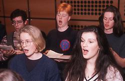 Secondary school pupils singing in choir,