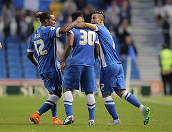 Kazenga LuaLua ( C ) of Brighton & Hove Albion celebrates with Gaetan Bong ( L ) and Biram Kayal after he scores the opening goal to make it 1-0 - Mandatory byline: Paul Terry/JMP - 07966386802 - 07/08/2015 - FOOTBALL - Falmer Stadium -Brighton,England - Brighton v Nottingham Forest - Sky Bet Championship