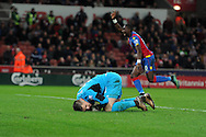 Stoke city goalkeeper Jack Butland slumps dejected as the Crystal Palace players run to celebrate their 2nd goal scored by Lee Chung-Yong. Barclays Premier league match, Stoke city v Crystal Palace at the Britannia Stadium in Stoke on Trent, Staffs on Saturday 19th December 2015.<br /> pic by Andrew Orchard, Andrew Orchard sports photography.