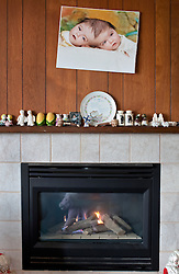 A photograph of four-year-old craniopagus twins Tatiana and Krista Hogan rests above the mantel in their home in Vernon, British Columbia, Canada, Feb. 26, 2011. The twins, born Oct. 25, 2006 to parents Felicia Simms and Brendan Hogan, are connected at the head and share a brain. Neurologists say the twins are the only such set that have a common neurological connection.