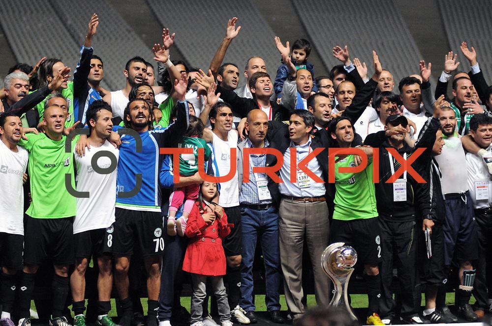 Konyaspor's players (Left to Right) (Front side) Ugur YANIKDEMIR, Erdal KILICARSLAN, Ramazan KAHYA, Yusuf KURTULUS, coach Ziya DOGAN, Omer HACISALIHOGLU celebrate with the BankAsya Cup trophy during their Turkish soccer Play Off final match Altayspor between Konyaspor at Ataturk Olympic Stadium in Istanbul Turkey on Sunday, 23 May 2010. Photo by TURKPIX