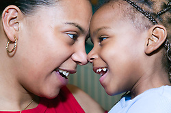 Mother and daughter touching noses,