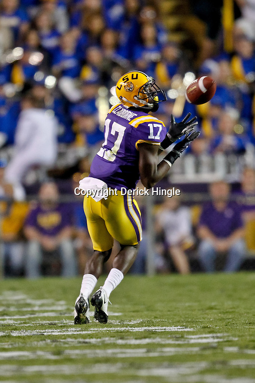 October 16, 2010; Baton Rouge, LA, USA; LSU Tigers cornerback Morris Claiborne (17) intercepts a pass against the McNeese State Cowboys during the second half at Tiger Stadium. LSU defeated McNeese State 32-10. Mandatory Credit: Derick E. Hingle