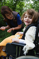 Child with brain damage out on a nature walk,