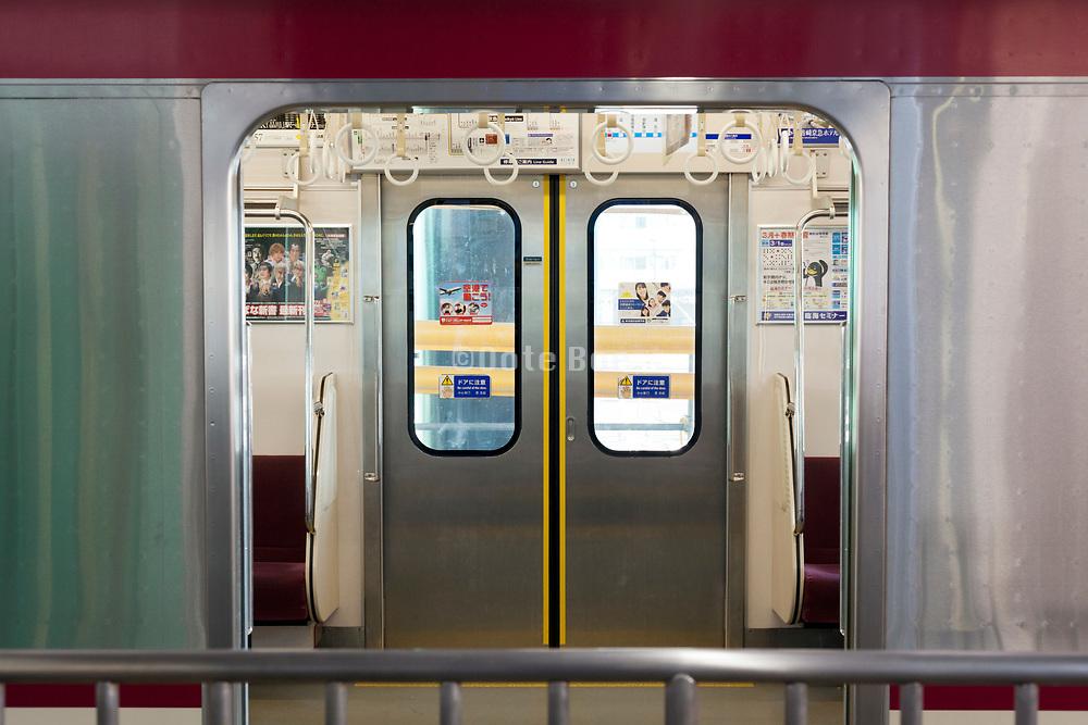 empty public transport train wagon on the Keikyu line in Japan