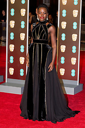 © Licensed to London News Pictures. 18/02/2018. LUPITA NYONG'O arrives on the red carpet for the EE British Academy Film Awards 2018, held at the Royal Albert Hall, London, UK. Photo credit: Ray Tang/LNP