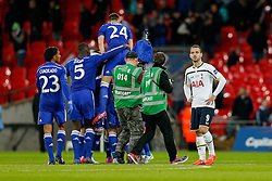 Roberto Soldado of Tottenham Hotspur looks dejected as Chelsea celebrate at the final whistle after winning the Capital One Cup Final - Photo mandatory by-line: Rogan Thomson/JMP - 07966 386802 - 01/03/2015 - SPORT - FOOTBALL - London, England - Wembley Stadium - Chelsea v Tottenham Hotspur - Capital One Cup Final.